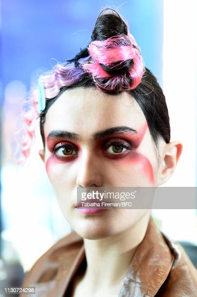 A model backstage ahead of the Zandra Rhodes Presentation during London Fashion Week February 2019 on February 19 2019 in London England
