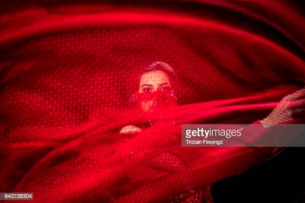 A model backstage ahead of the Zeynep Tosun show during Mercedes Benz Fashion Week Istanbul at Zorlu Performance Hall on March 30 2018 in Istanbul...