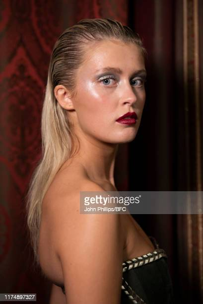 A model backstage at the AADNEVIK show during London Fashion Week September 2019 at The Royal Horseguards on September 15 2019 in London England