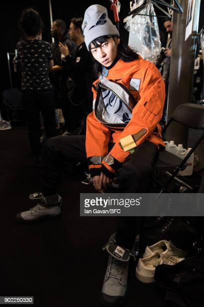 A model backstage at the Christopher Raeburn show during London Fashion Week Men's January 2018 at BFC Show Space on January 7 2018 in London England