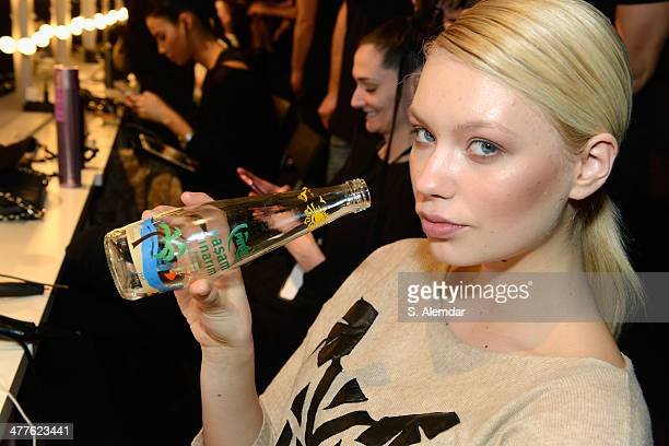 A model backstage at the DB Berdan By L'Oreal Professional show during MBFWI presented by American Express Fall/Winter 2014 on March 10 2014 in...