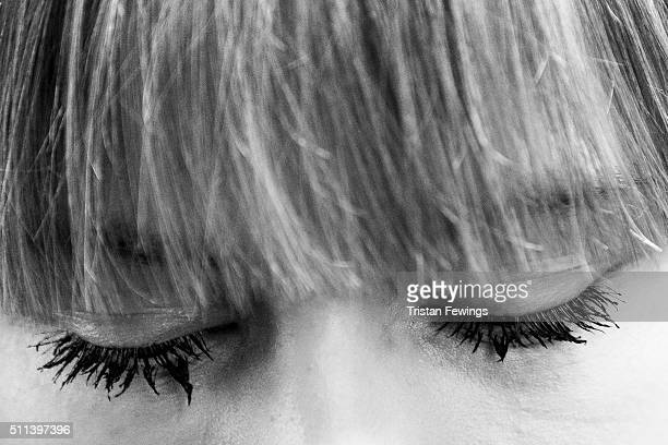 A model backstage at the Eudon Choi show during London Fashion Week Autumn/Winter 2016/17 at the BFC Show Space Brewer Street on February 19 2016 in...