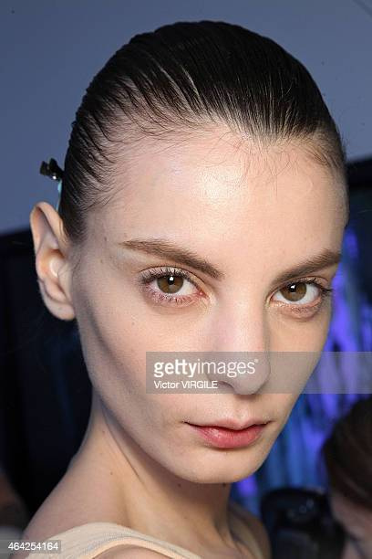 A model backstage at the Jonathan Saunders show during London Fashion Week Fall/Winter 2015/16 at TopShop Show Space on February 22 2015 in London...