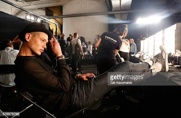 A model backstage at the Oliver Spencer show during The London Collections Men SS16 at The Old Sorting Office on June 13 2015 in London England