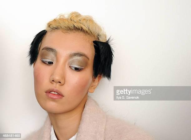 A model backstage at the Zero Maria Cornejo fashion show during MercedesBenz Fashion Week Fall 2014 on February 10 2014 in New York City