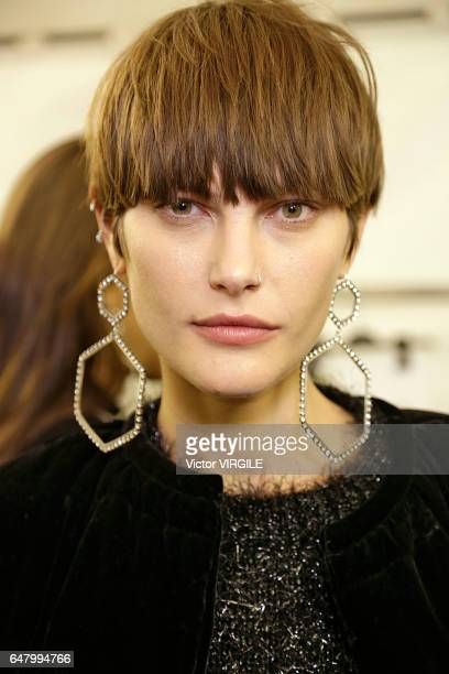 A model backstage during the Isabel Marant Ready to Wear fasshion show as part of the Paris Fashion Week Womenswear Fall/Winter 2017/2018 on March 2...