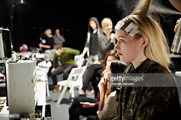 Model backstage in hair and make-up
