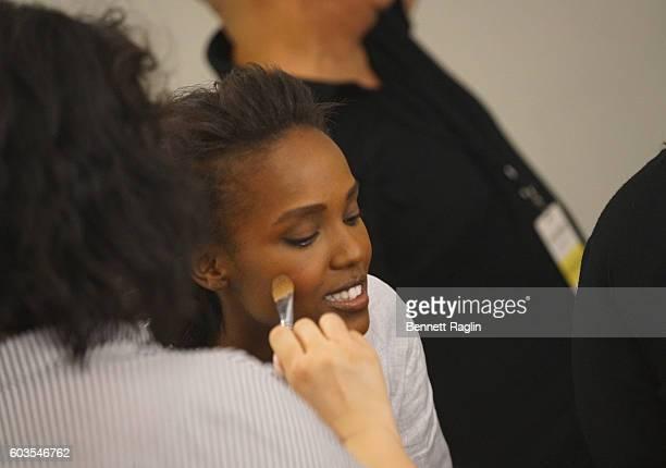 A model backstage prepares for Zac Posen Backstage September 2016 New York Fashion Week at Spring Studios on September 12 2016 in New York City