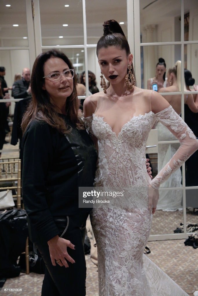 A model backstage with the creative director at the Berta Runway show during New York Fashion Week: Bridal April 2017 at The Plaza Hotel on April 21, 2017 in New York City.
