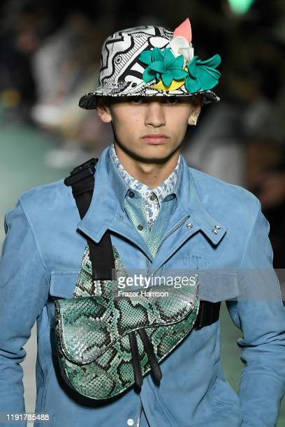 A model bag and hat detail walks the runway at Dior Men's PreFall 2020 Runway Show on December 03 2019 in Miami Florida
