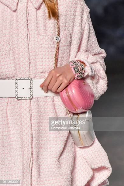 A model bag and jewelry detail walks the runway during the Chanel Cruise 2018/2019 Collection at Le Grand Palais on May 3 2018 in Paris France