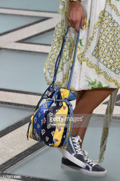 Model, bag and shoe detail, walks the runway at the Tory Burch Ready to Wear Spring/Summer 2020 fashion show during New York Fashion Week on...
