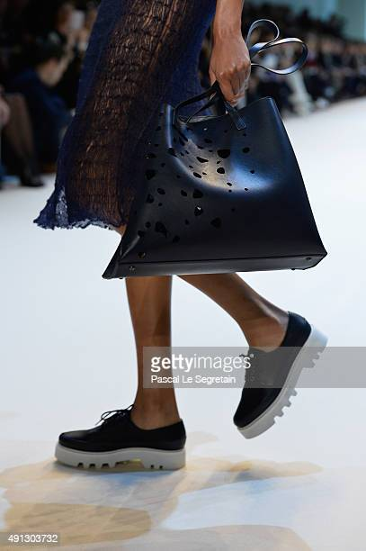 A model bag and shoe detail walks the runway during the Akris show as part of the Paris Fashion Week Womenswear Spring/Summer 2016 on October 4 2015...