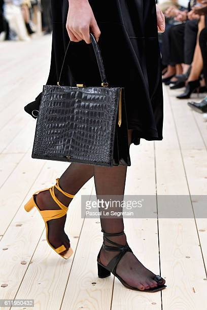 A model bag and shoe detail walks the runway during the Celine show as part of the Paris Fashion Week Womenswear Spring/Summer 2017 on October 2 2016...