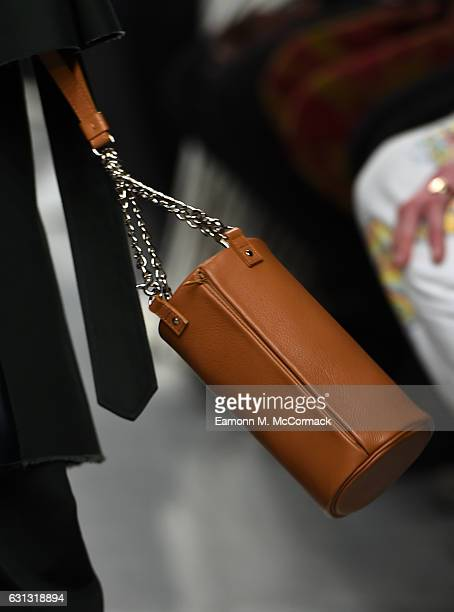 Model, bag detail, walks the runway at John Lawrence Sullivan during London Fashion Week Men's January 2017 collections at BFC Show Space on January...
