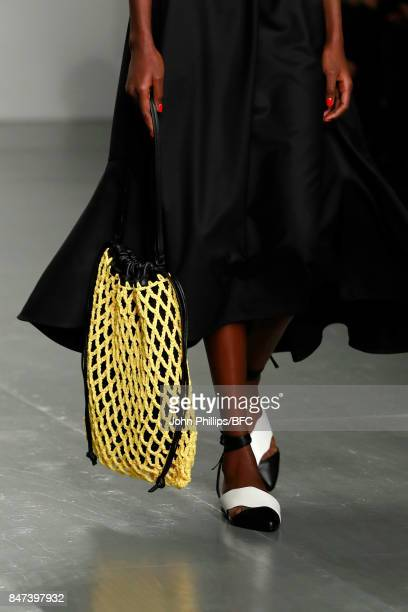 A model bag detail walks the runway at the Eudon Choi show during London Fashion Week September 2017 on September 15 2017 in London England