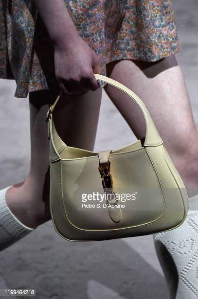 Model, bag detail, walks the runway at the Gucci show during Milan Menswear Fashion Week Fall/Winter 2020/21 on January 14, 2020 in Milan, Italy.