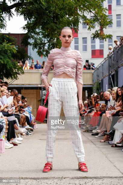 A model bag detail walks the runway at the Marina Hoermanseder show during the Berlin Fashion Week Spring/Summer 2019 at ewerk on July 5 2018 in...