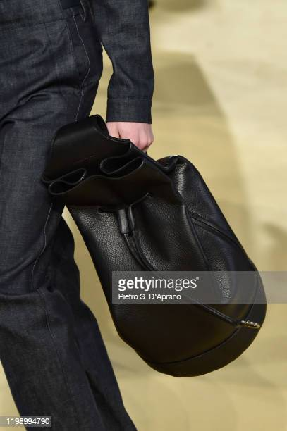 Model, bag detail, walks the runway at the Salvatore Ferragamo fashion show on January 12, 2020 in Milan, Italy.