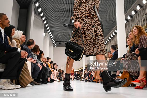 Model, bag detail, walks the runway at the Tod's show at Milan Fashion Week Autumn/Winter 2019/20 on February 22, 2019 in Milan, Italy.