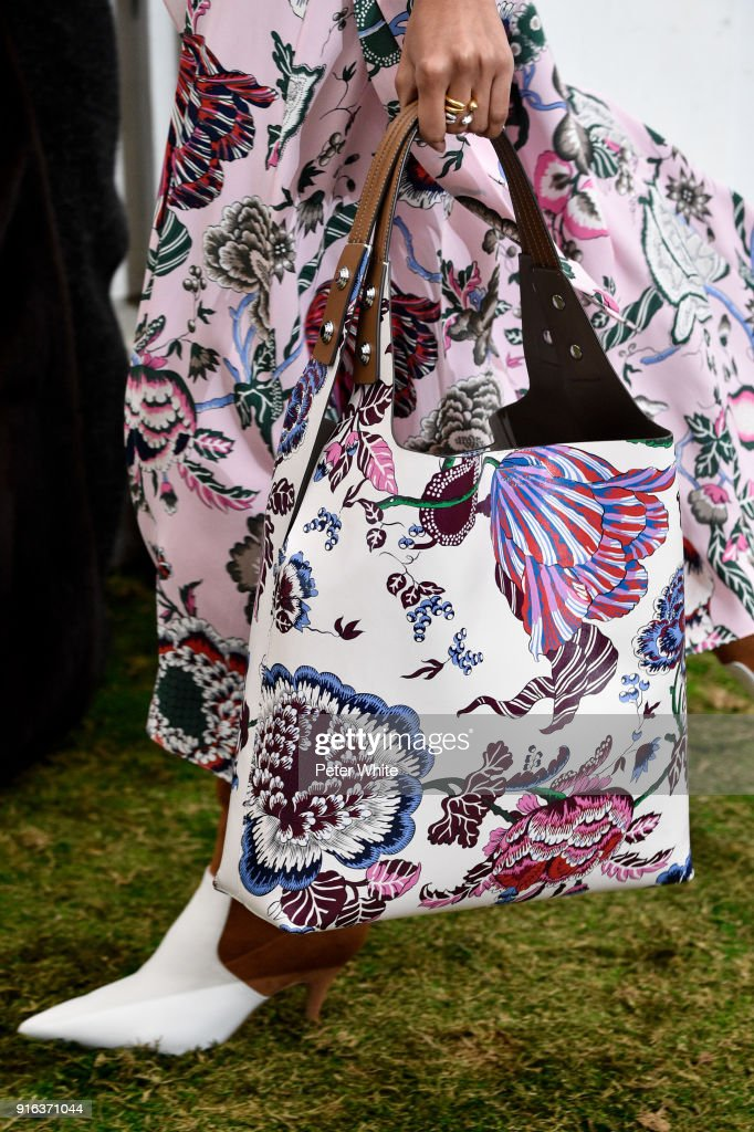 A model, bag detail, walks the runway at the Tory Burch Fall Winter 2018 Fashion Show during New York Fashion Week at Bridge Market on February 9, 2018 in New York City.