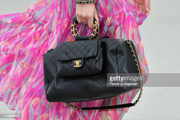 A model bag detail walks the runway during Chanel Cruise 2020 Collection at Le Grand Palais on May 03 2019 in Paris France