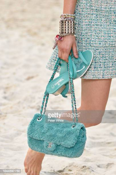 Model, bag detail, walks the runway during the Chanel show as part of the Paris Fashion Week Womenswear Spring/Summer 2019 on October 2, 2018 in...