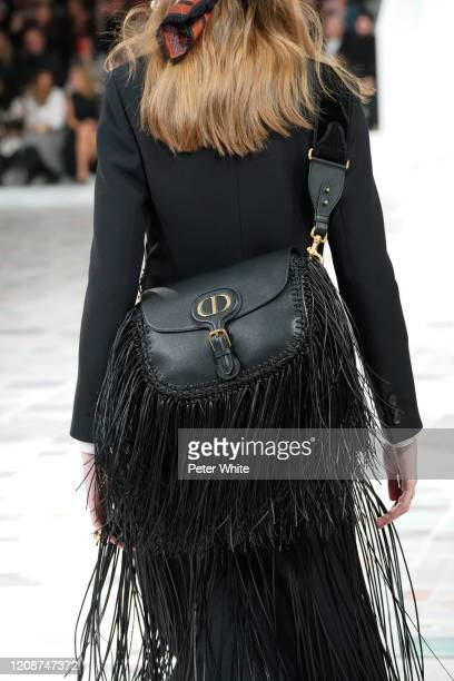 Model, bag detail, walks the runway during the Dior show as part of the Paris Fashion Week Womenswear Fall/Winter 2020/2021 on February 25, 2020 in...