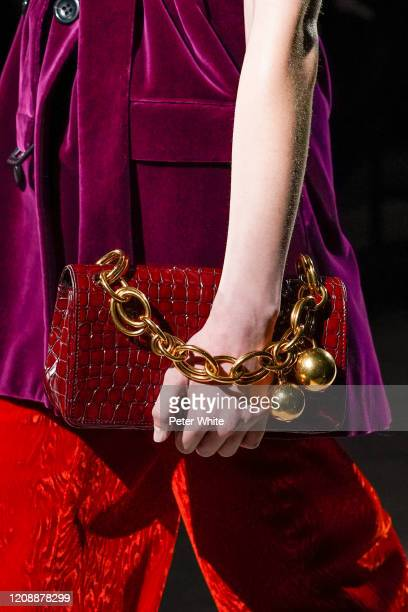 Model, bag detail, walks the runway during the Dries Van Noten show as part of the Paris Fashion Week Womenswear Fall/Winter 2020/2021 on February...