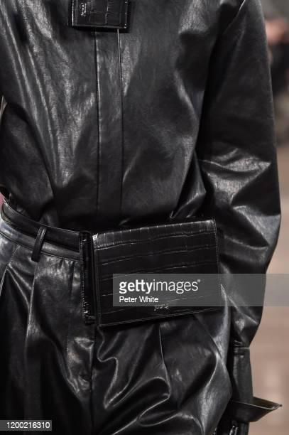 Model, bag detail, walks the runway during the Juun J Menswear Fall/Winter 2020-2021 show as part of Paris Fashion Week on January 17, 2020 in Paris,...