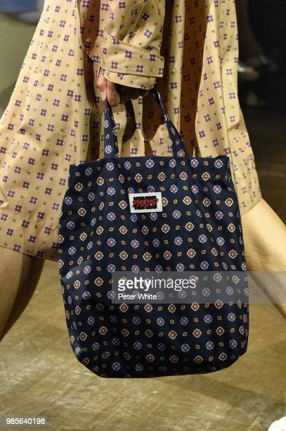 A model bag detail walks the runway during the Kenzo Menswear Spring/Summer 2019 show as part of Paris Fashion Week on June 24 2018 in Paris France