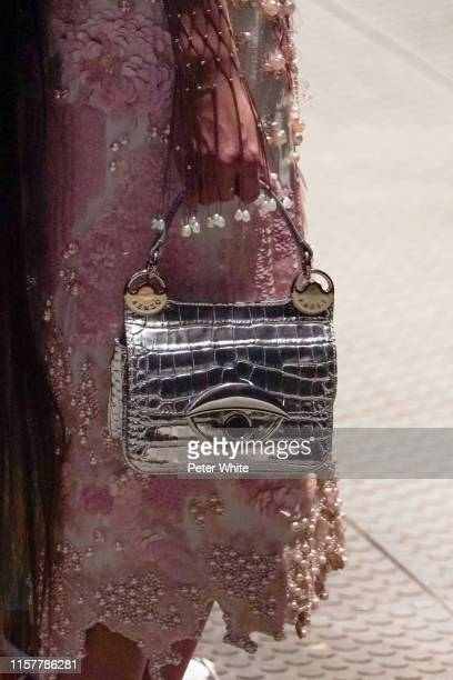Model, bag detail, walks the runway during the Kenzo Menswear Spring Summer 2020 show as part of Paris Fashion Week on June 23, 2019 in Paris, France.