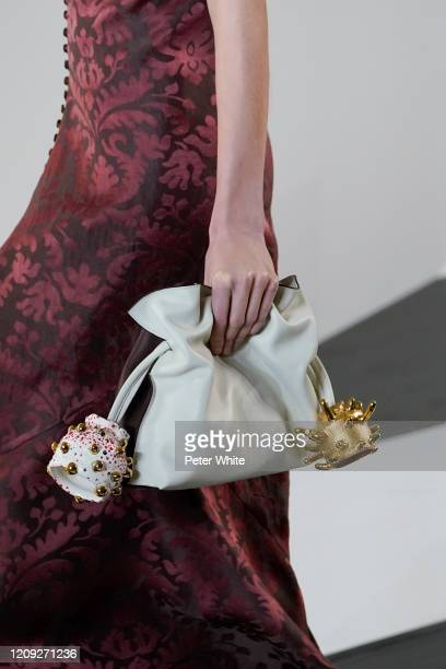 Model, bag detail, walks the runway during the Loewe show as part of the Paris Fashion Week Womenswear Fall/Winter 2020/2021 on February 28, 2020 in...