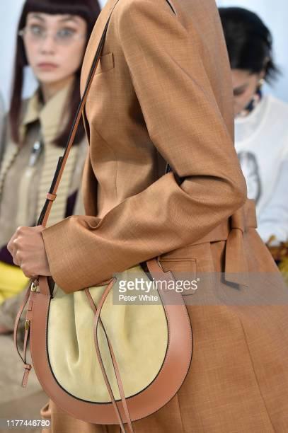 Model, bag detail, walks the runway during the Loewe Womenswear Spring/Summer 2020 show as part of Paris Fashion Week on September 27, 2019 in Paris,...