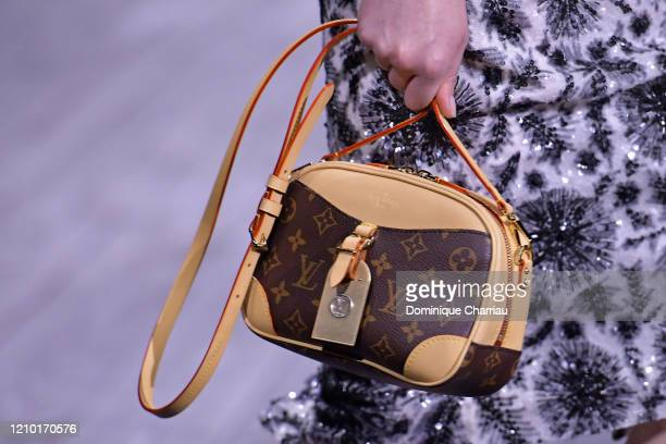 Model, bag detail, walks the runway during the Louis Vuitton show as part of the Paris Fashion Week Womenswear Fall/Winter 2020/2021 on March 03,...