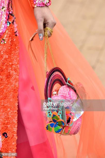 Model, bag detail, walks the runway during the Manish Arora show as part of the Paris Fashion Week Womenswear Fall/Winter 2018/2019 on March 1, 2018...