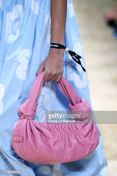 Model, bag detail, walks the runway during the Miu Miu Womenswear Spring/Summer 2020 show as part of Paris Fashion Week on October 01, 2019 in Paris,...