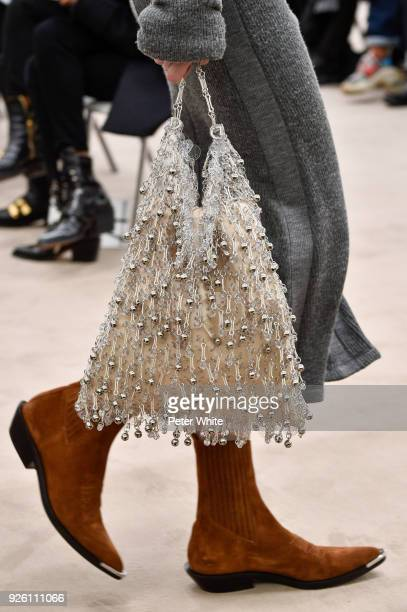 Model, bag detail, walks the runway during the Paco Rabanne show as part of the Paris Fashion Week Womenswear Fall/Winter 2018/2019 on March 1, 2018...
