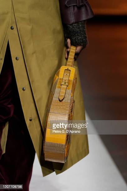 Model, bag detail, walks the runway during the Tod's fashion show as part of Milan Fashion Week Fall/Winter 2020-2021 on February 21, 2020 in Milan,...
