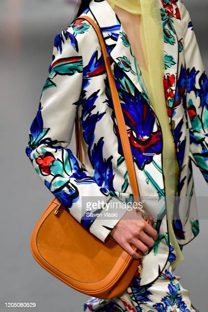 Model, bag detail, walks the runway during the Tory Burch Fall Winter 2020 Fashion Show at Sotheby's on February 09, 2020 in New York City.