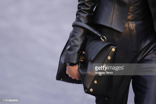 Model, bag details, walks the runway at the Roberto Cavalli show at Milan Fashion Week Autumn/Winter 2019/20 on February 23, 2019 in Milan, Italy.