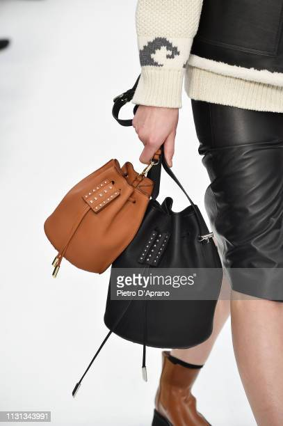 Model, bag details, walks the runway at the Tod's show at Milan Fashion Week Autumn/Winter 2019/20 on February 22, 2019 in Milan, Italy.