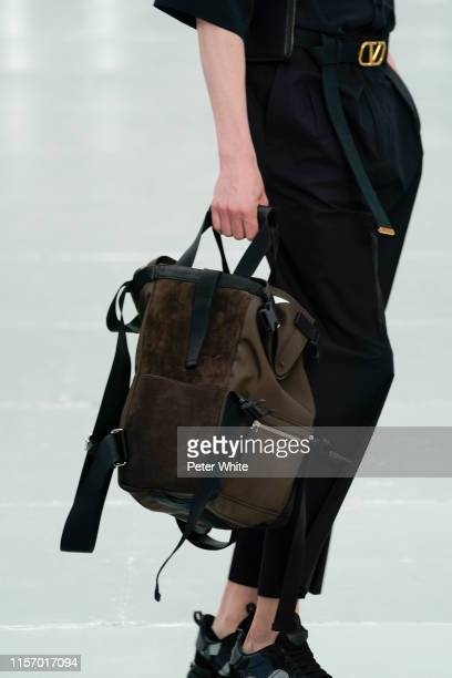 Model, bag details, walks the runway at the Valentino Menswear Spring Summer 2020 show as part of Paris Fashion Week on June 19, 2019 in Paris,...