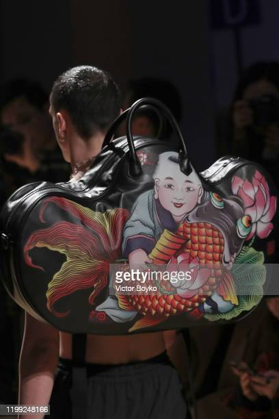 A model bag detailwalks the runway at the Reshake fashion show on January 13 2020 in Milan Italy