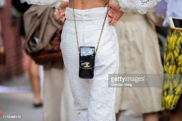Model Bambi Northwood Blyth is seen wearing white sheer top and and pants, Chanel bag during New York Fashion Week September 2019 on September 09,...