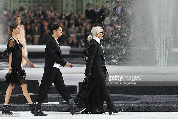 A model Baptiste Giabicon and Karl Lagerfeld walk the runway during the Chanel Ready to Wear Spring/Summer 2011 show during Paris Fashion Week at...