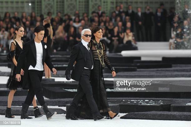 A model Baptiste Giabiconi Karl Lagerfeld and Ines de la Fressange walk the runway during the Chanel Ready to Wear Spring/Summer 2011 show during...