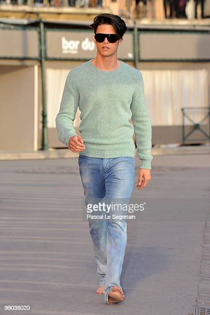 Model Baptiste Giabiconi walks the runway during the Chanel Cruise Collection Presentation on May 11, 2010 in Saint-Tropez, France.