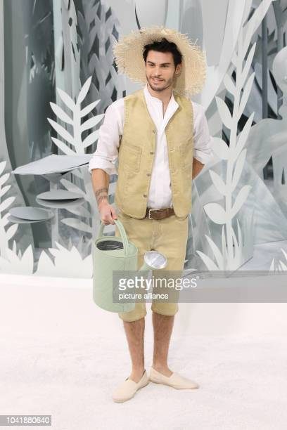 Model Baptiste Giabiconi wears a creation by German designer Lagerfeld as part of Chanel spring/summer 2015 collection presented during the Paris...