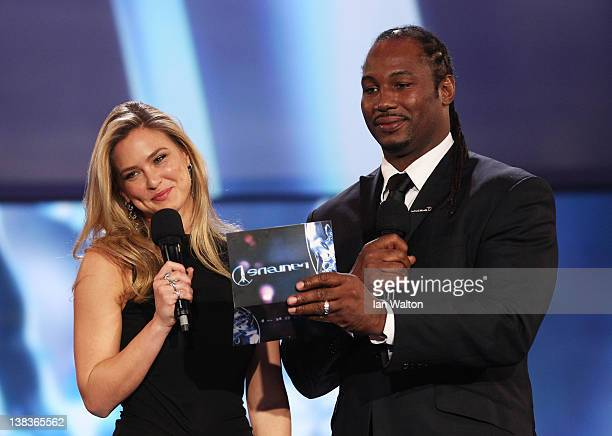 Model Bar Refaeli and Boxer Lennox Lewis speak on stage at the 2012 Laureus World Sports Awards at Central Hall Westminster on February 6 2012 in...